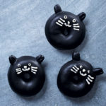 Dark chocolate-glazed black cat doughnuts