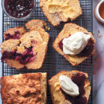 Cranberry scone loaf with butter, raspberry jam and whipped cream