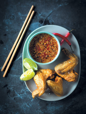 Crispy chicken wings with Cambodian tuk trey dipping sauce