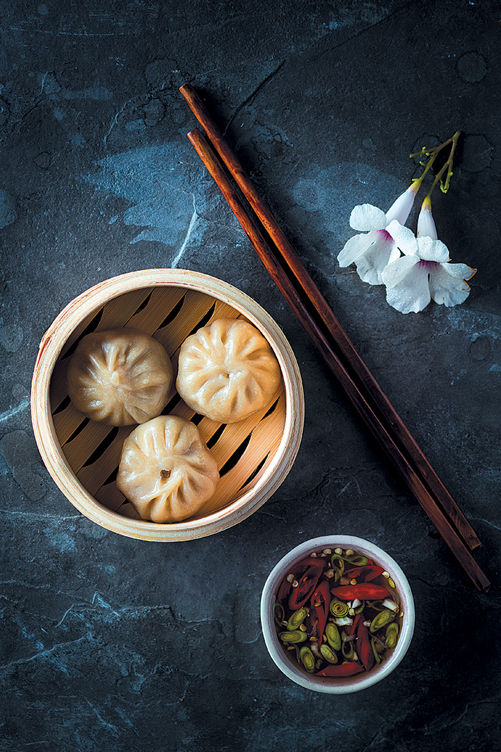 Steamed pork dumplings with Asian dipping sauce