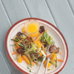 Sweet and sticky Thai stir-fried pork belly and mango salad