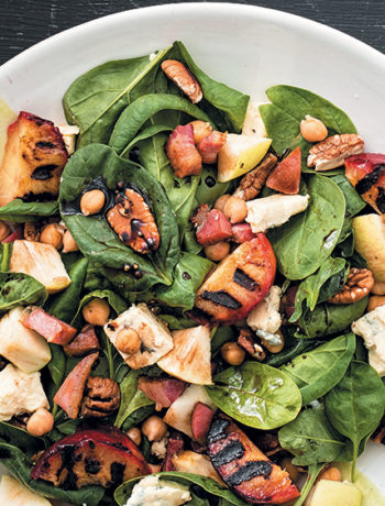 Spinach, chickpea, Gorgonzola and pecan nut salad with grilled plums
