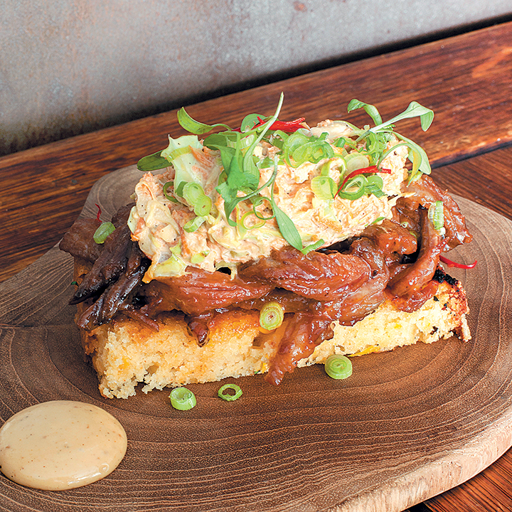 Pulled beef brisket on cornbread and Asian-style miso slaw