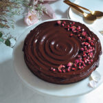 Hazelnut chocolate torte with dark chocolate ganache icing