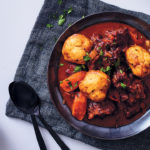 Oxtail with herby polenta dumplings