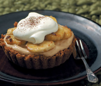 Individual banoffee pies with flambéed bananas and cream