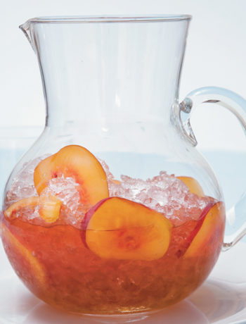 Jug of iced muscadel with slices of peach and nectarine