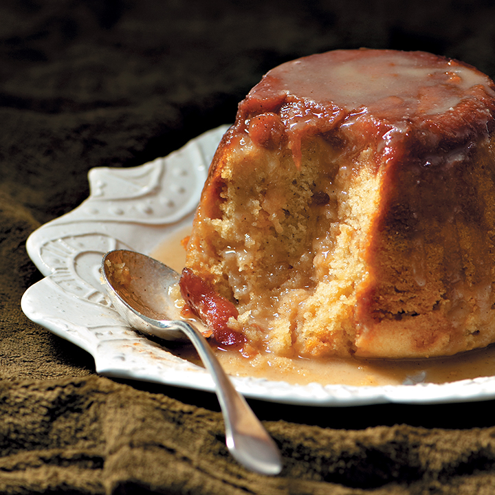 Steamed apple and almond pudding with marzipan and cider sauce