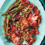One-pan Mediterranean-style tomato and trout bake with asparagus and green olives