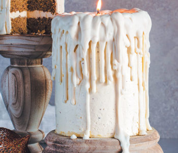 "Dripping white chocolate ""candle"" cakes with eggnog sponge and nutmeg-rum buttercream icing"