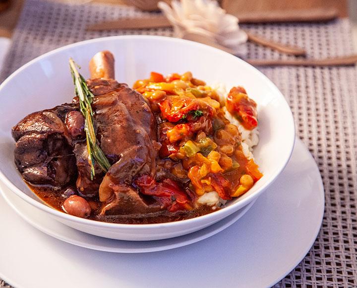 Roasted lamb shanks with creamy samp and Durban curry chakalaka