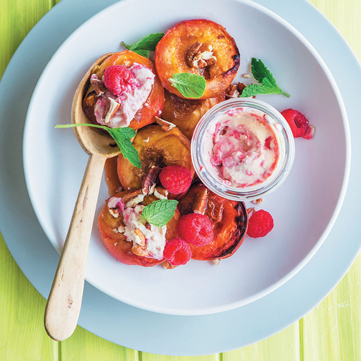 Baked peaches with raspberry-rippled ricotta and pecan nuts