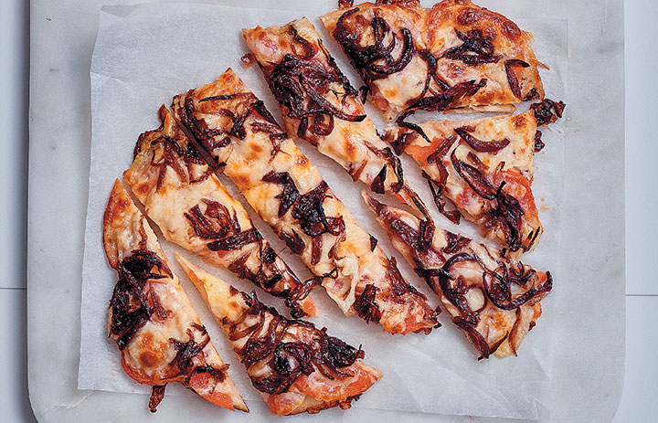 Caramelised onion and tomato naan pizza