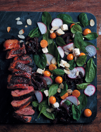Duck breast in raspberry jam herb marinade with caramelised onion and spinach salad