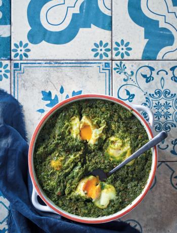 Herb and spinach green shakshuka