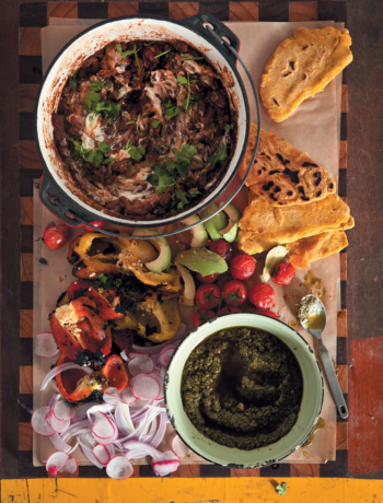 Barbecue pork shoulder with black beans, chimichurri and pupusas