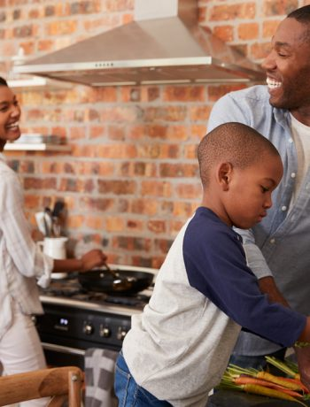 Family in the kitchen cooking together