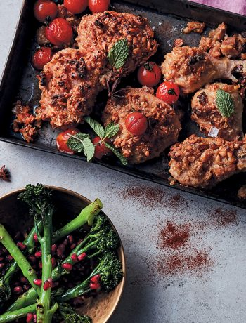 Roasted hummus and peanut crusted chicken with cherry tomatoes and broccolini